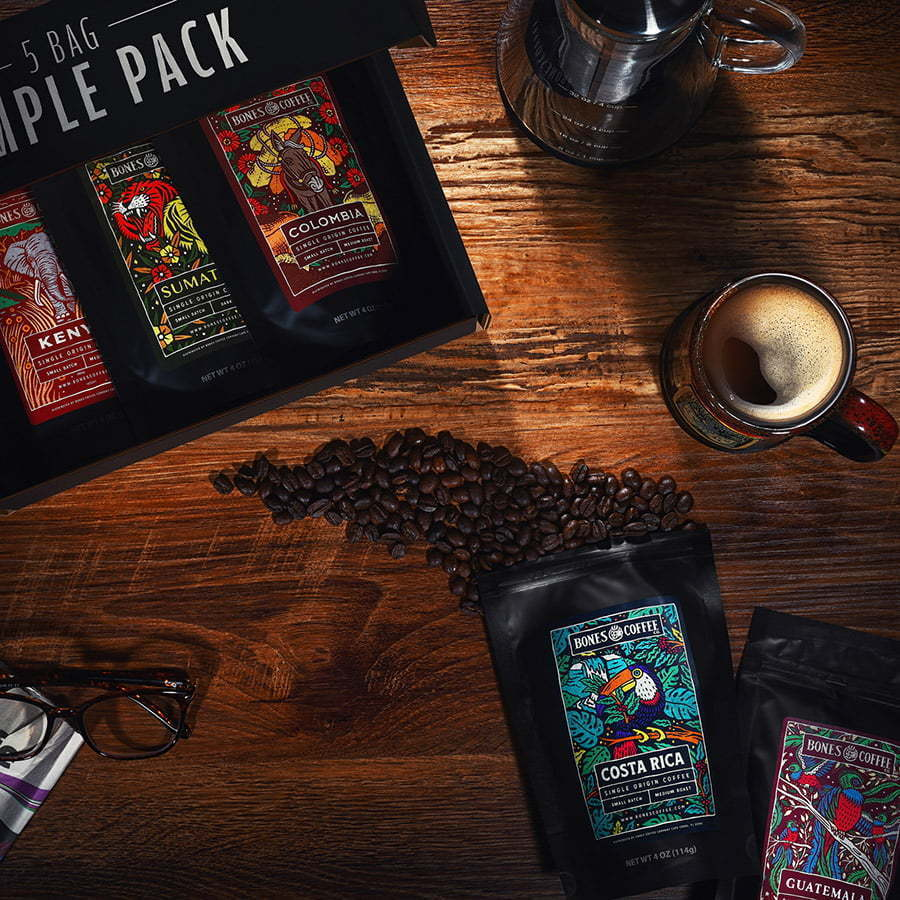 coffee lifestyle on a wood table coffee bags and cup of coffee custom photography