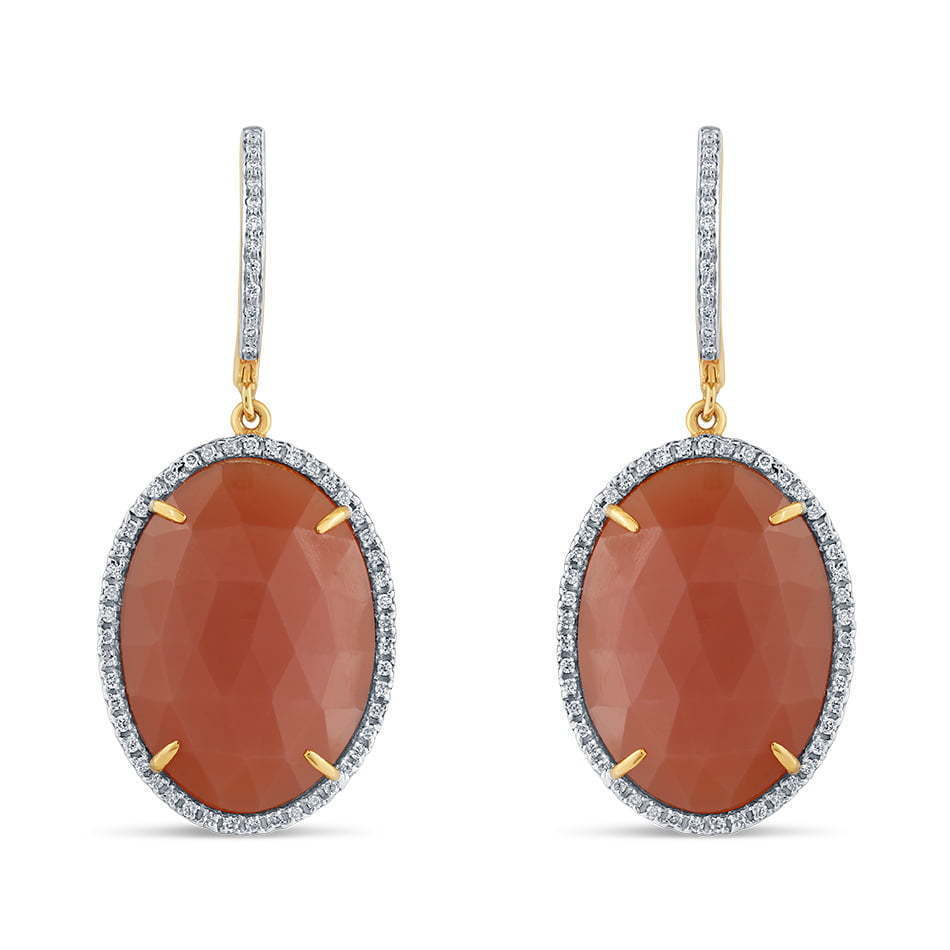 pair of red stone earrings jewelry photography
