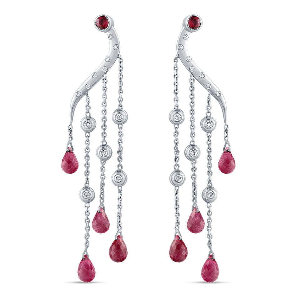 pair of silver and red stone dangling earrings jewelry photography