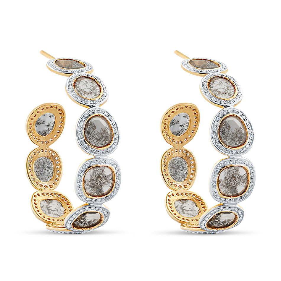 pair of stone diamond hoops side angle photography