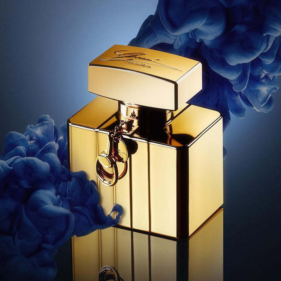 gold perfume bottle with blue smoke custom photography lifestyle