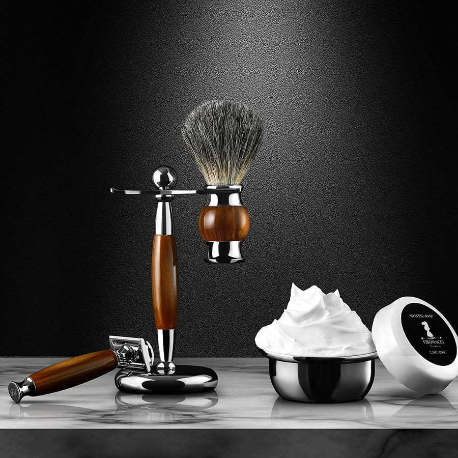 men's shaving cream brush with stand and shaving cream jar on a table custom photography