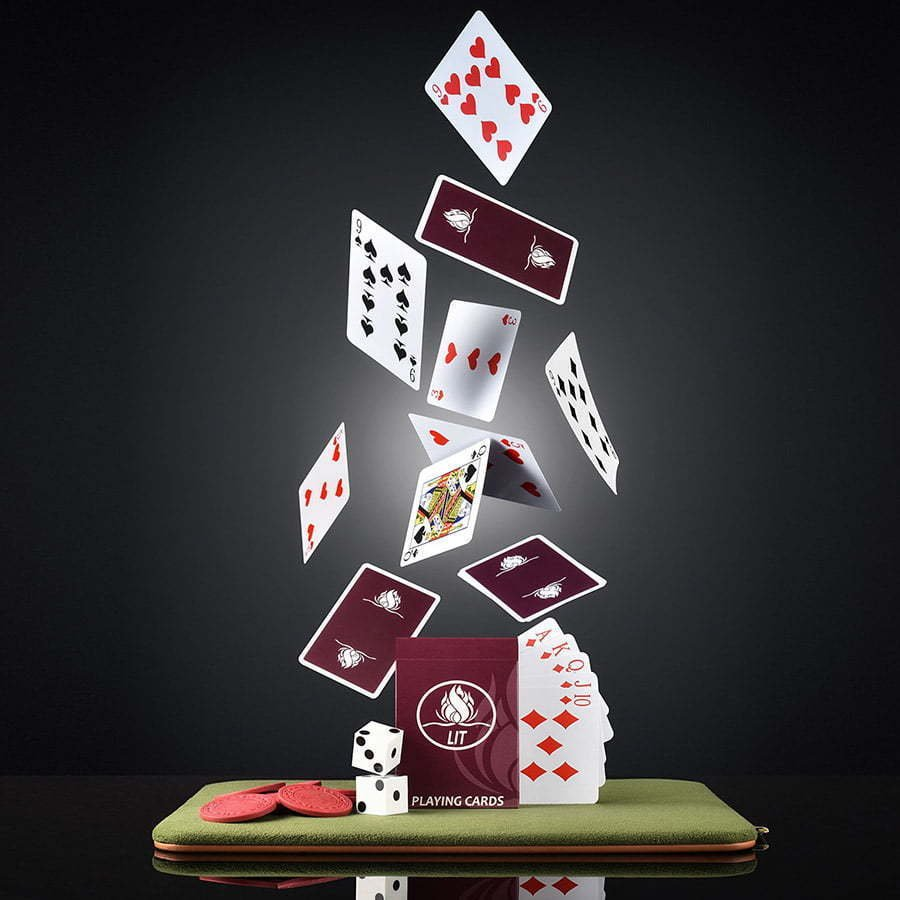 poker playing cards floating in air on poker mat custom photography