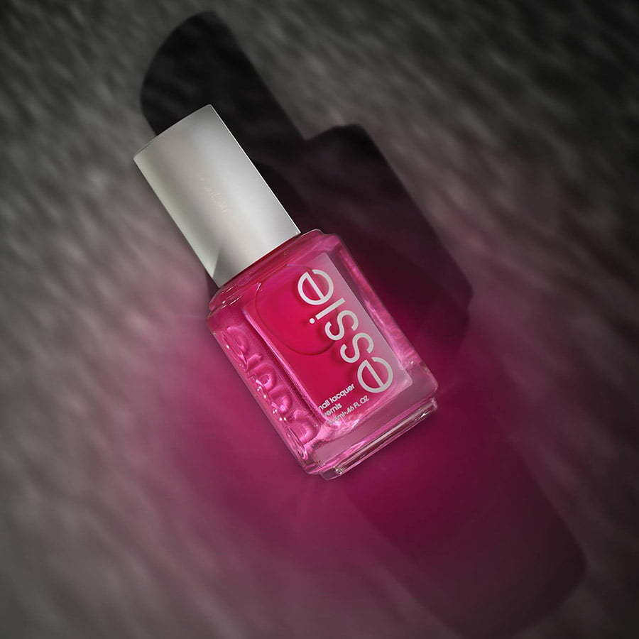 pink essie nail polish lay flat top shot image custom photography