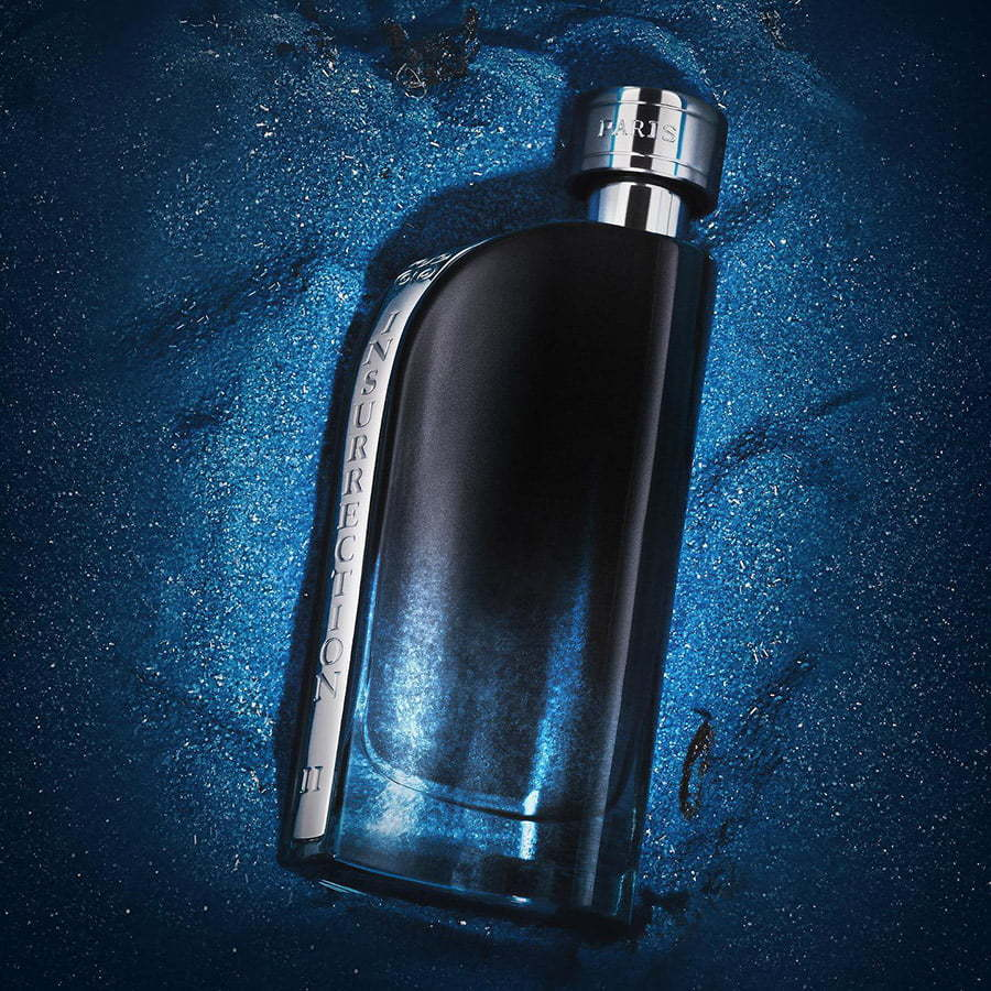 perfume cologne lay flat on a blue sand custom photography