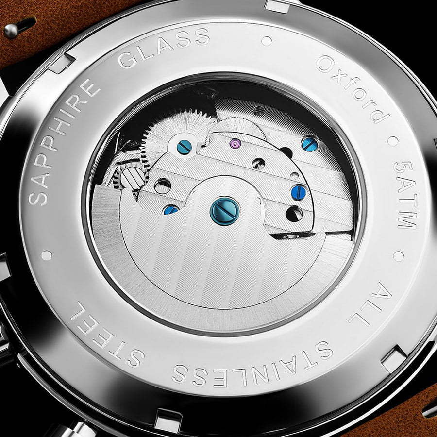 close-up detail shot of the back of a watch mechanics custom photography