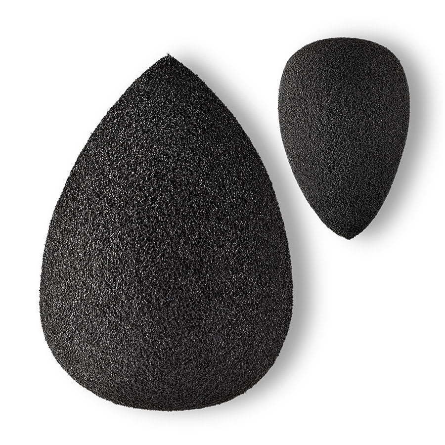 a photo of black makeup beauty sponges on a white background