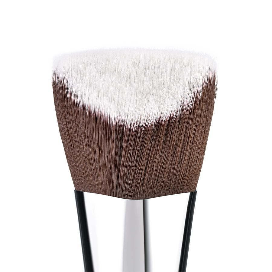 a detail close photo of a makeup brush hairs on a white background