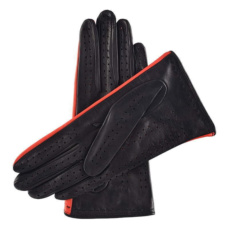 a pair of black leather gloves with red detail apparel photography