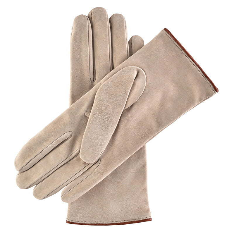 a pair of tan leather gloves apparel photography