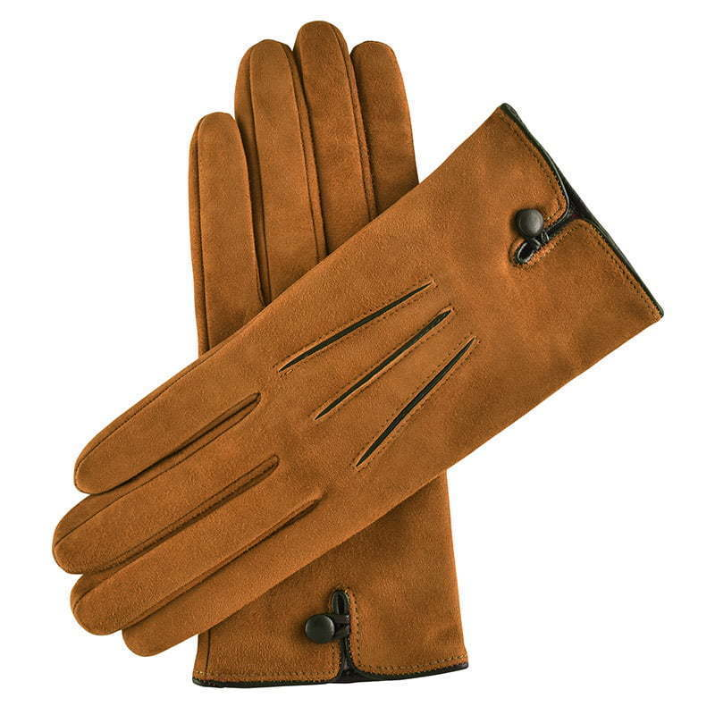 a pair of brown leather gloves with a black button closure apparel photography