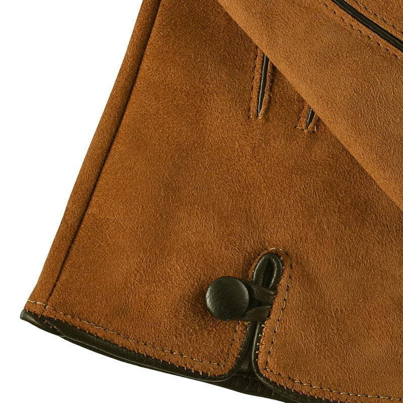 brown leather glove with black button apparel photography