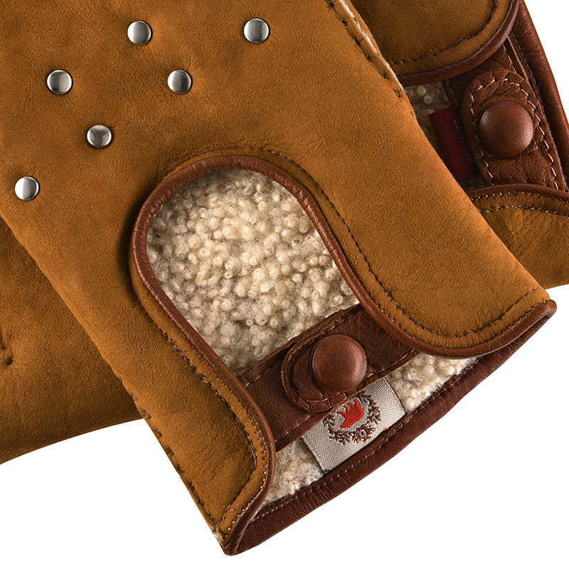 detailed photo of brown leather gloves with wool inside and metal grommets apparel  photography