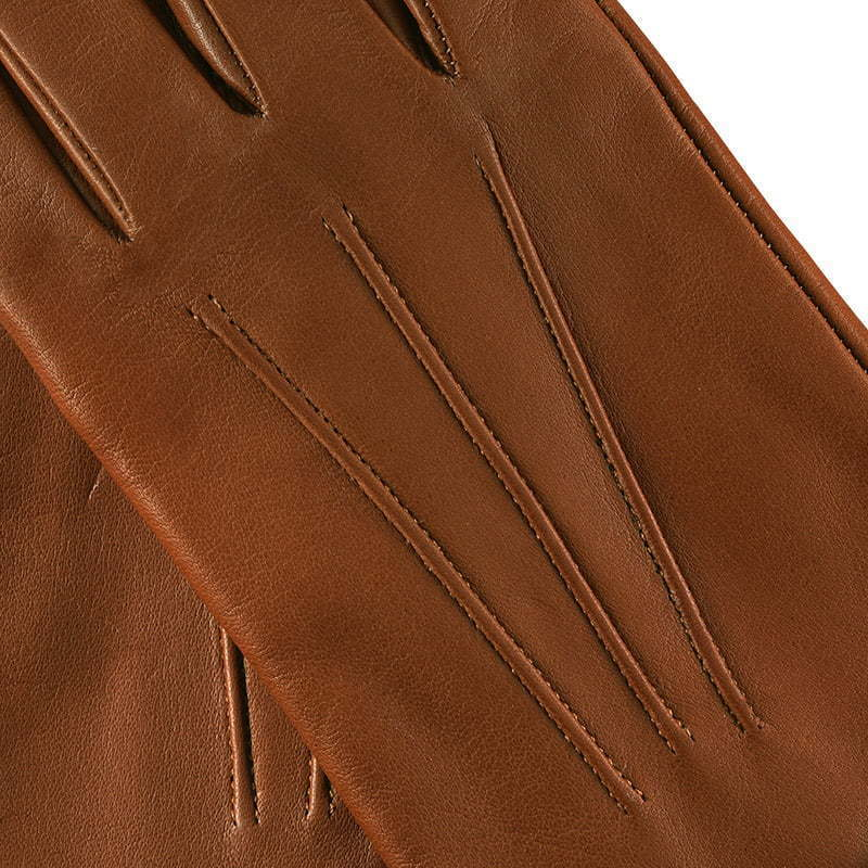 a pair of brown leather gloves apparel accessories photography