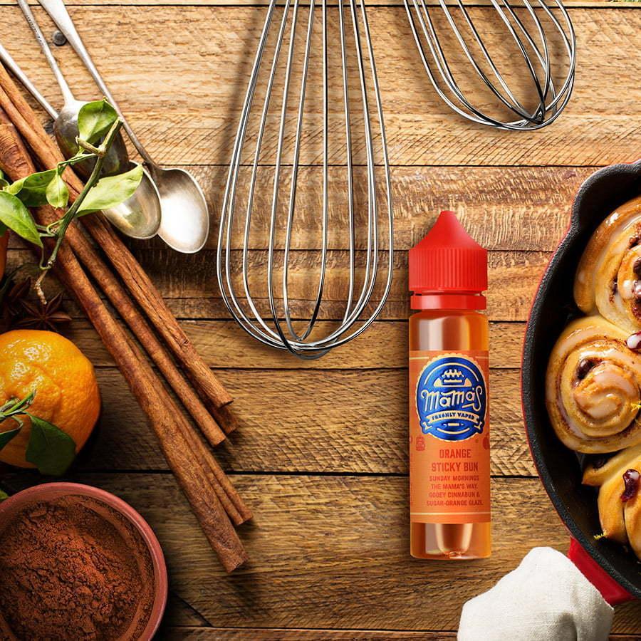flavored vape juice flat lay on wood table with cinnamon rolls custom photography