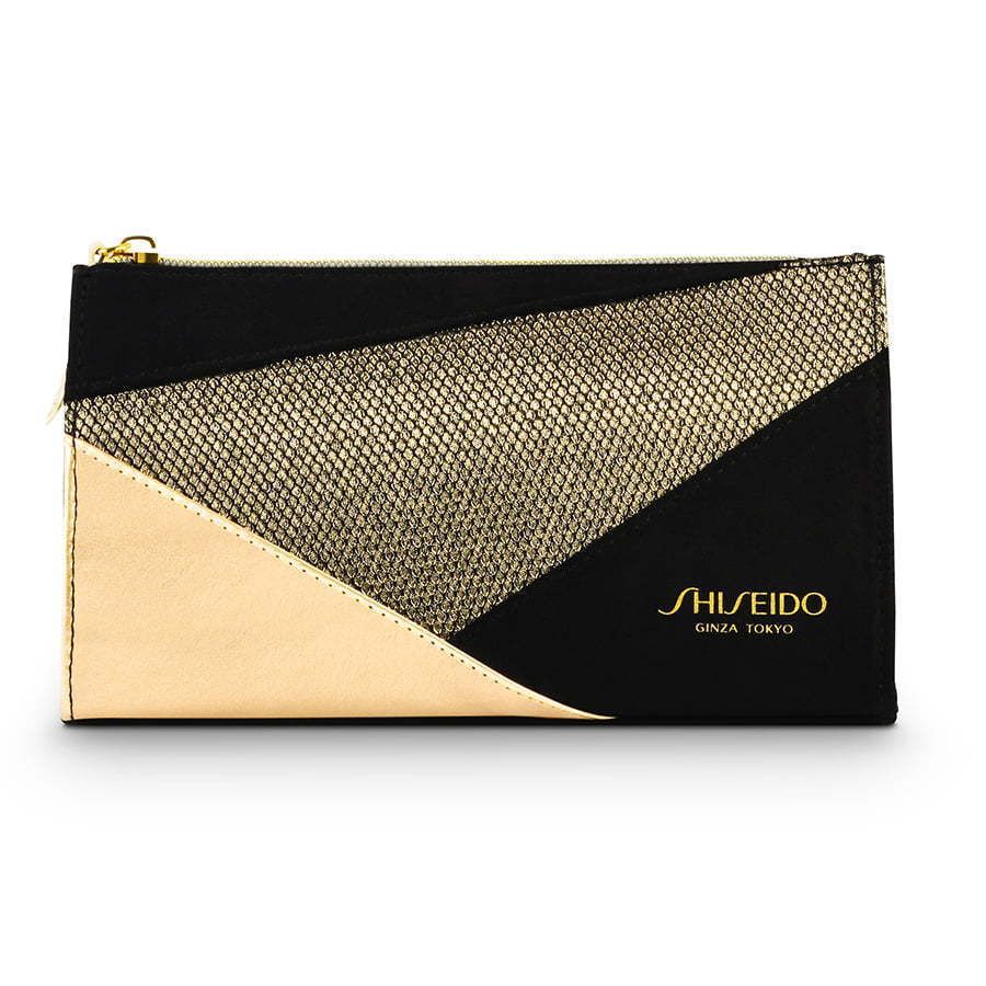 Black and gold small color blocked makeup bag photography