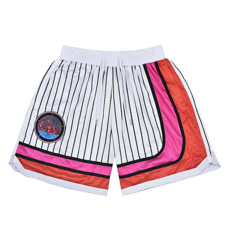 white striped basketball shorts with patch lay flat image photography