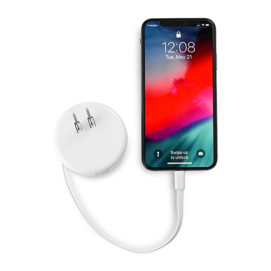 white retractable wall charging plug connected to a phone photography