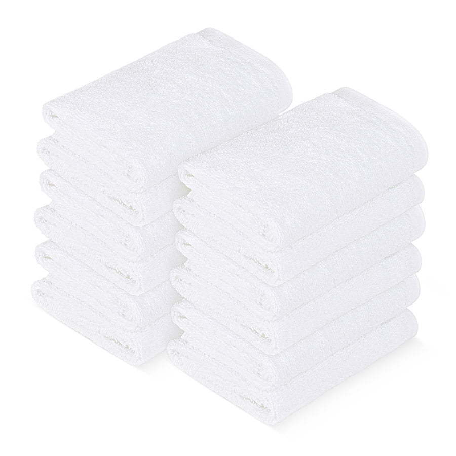 a group of stacked folded white hand towels photography