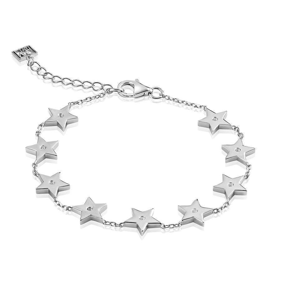 silver bracelet with silver stars in a circle photography