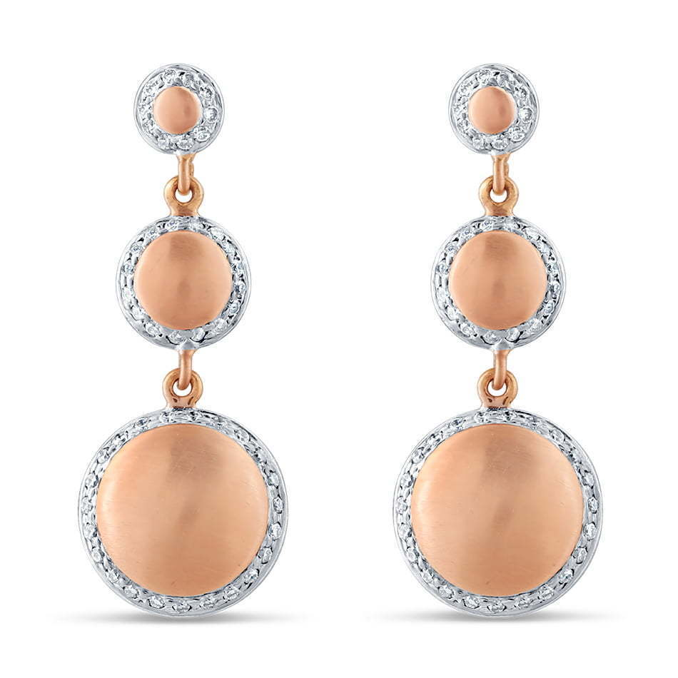 pair of three stone earrings with diamonds