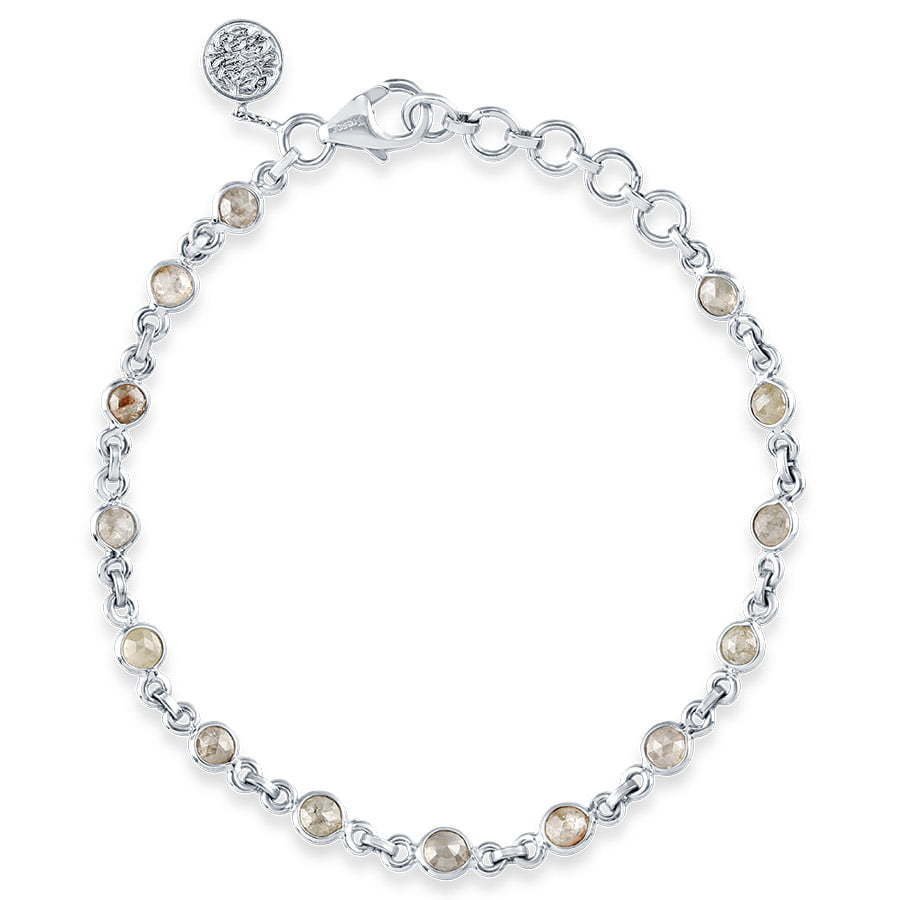 silver beaded bracelet with clasp in circle photography