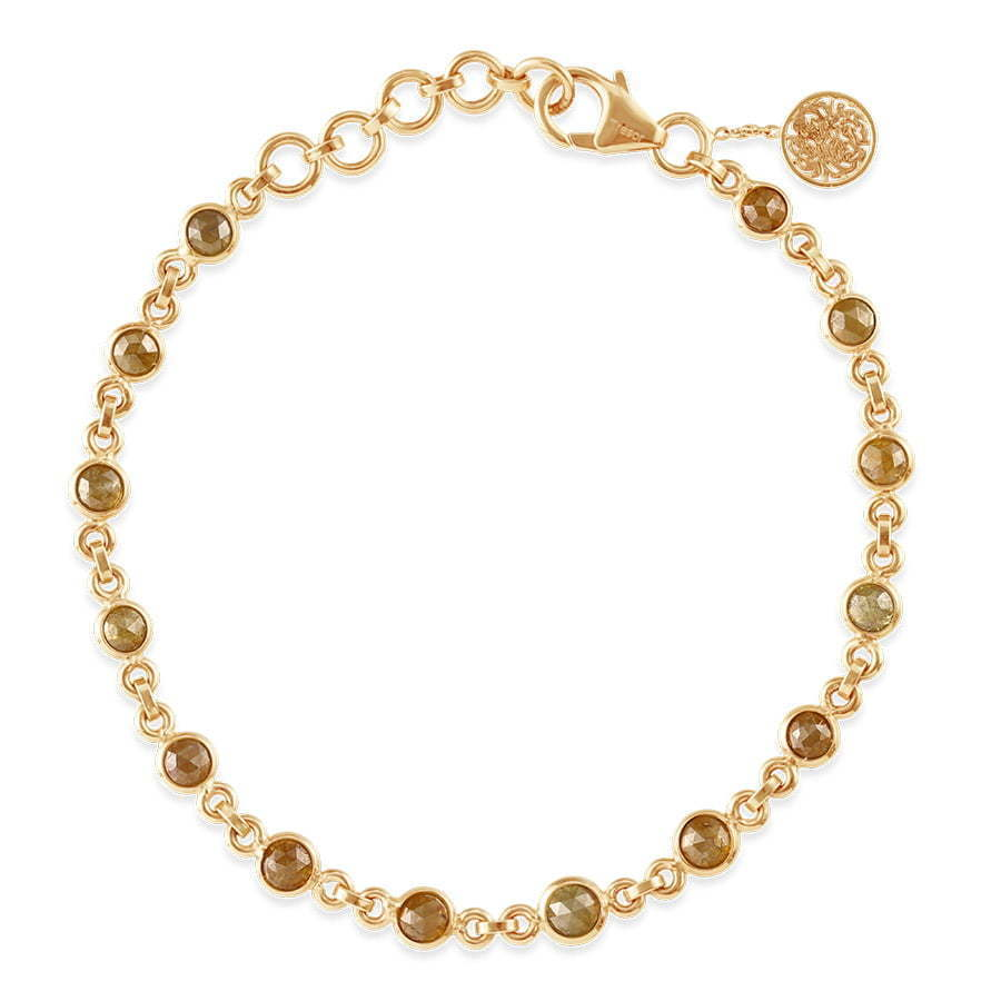 gold beaded bracelet with clasp in circle photography