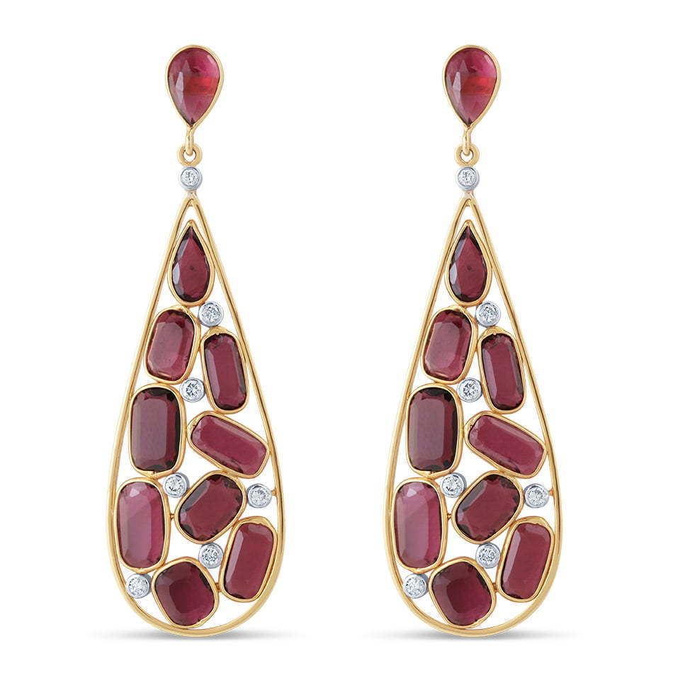 pair of red stone dangling earrings jewelry photography