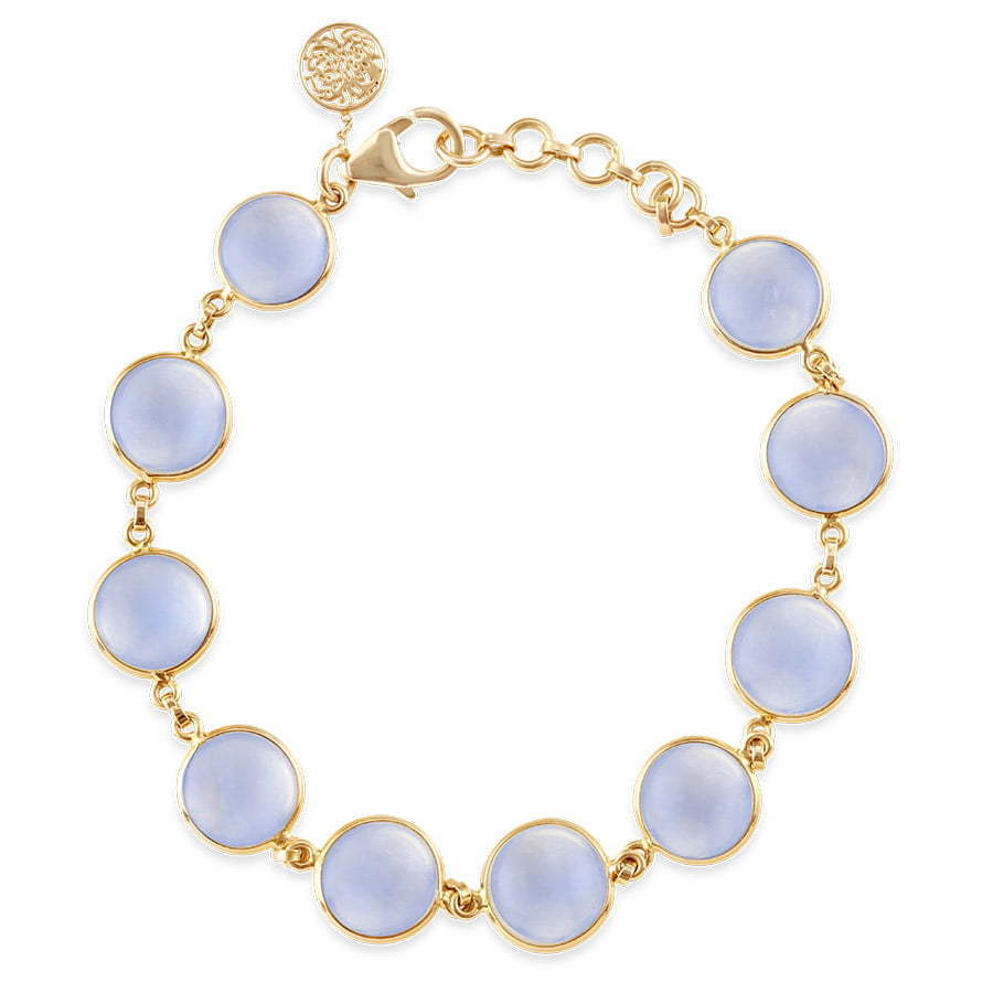gold bracelet with light blue circle stone photography