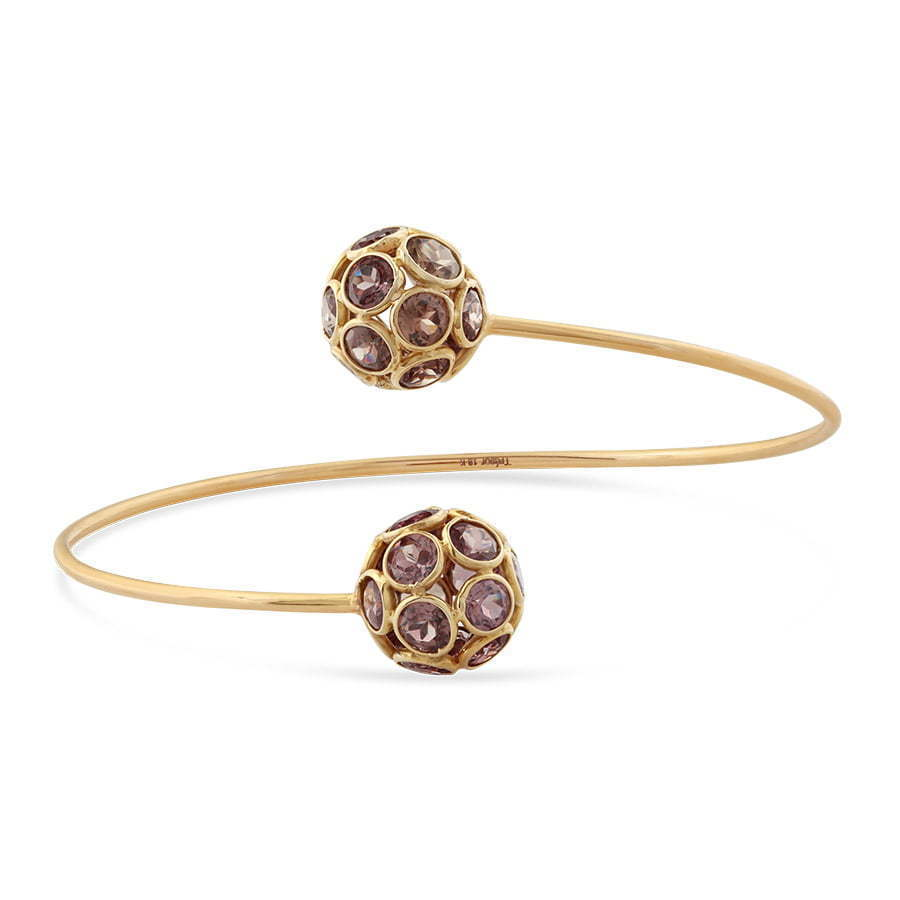 gold metal thin bracelet with spheres photography