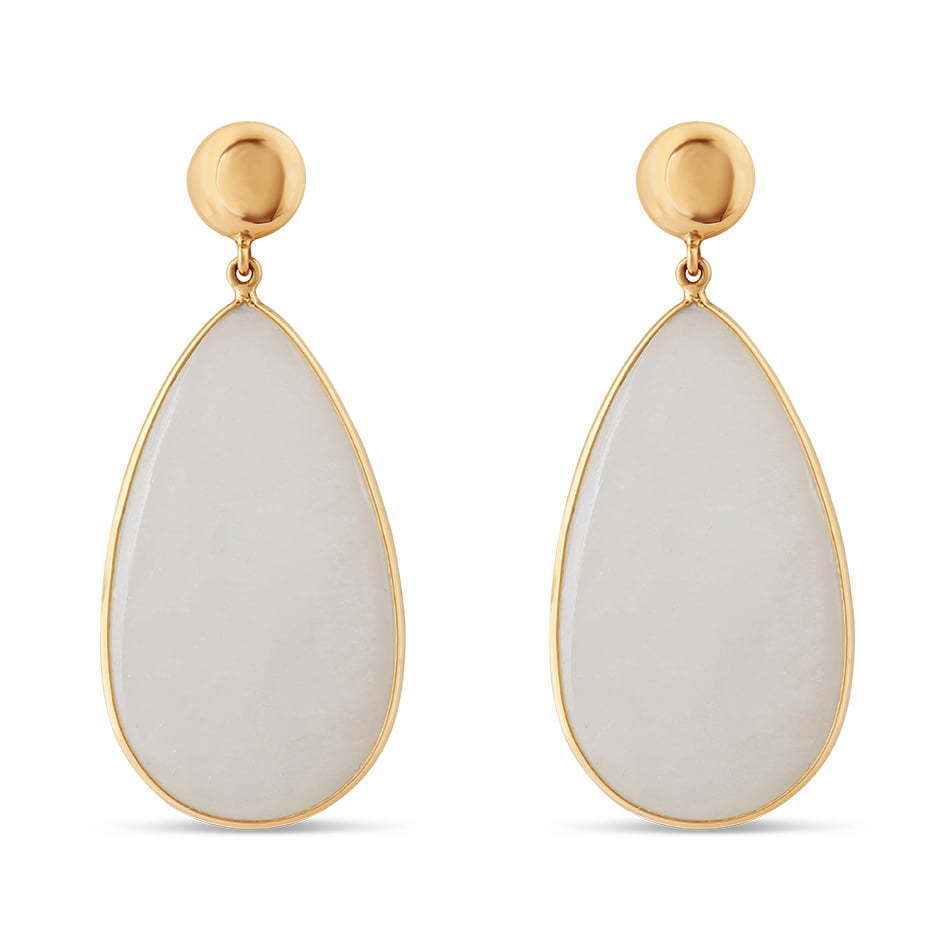 white stone gold dangling earring jewelry photography