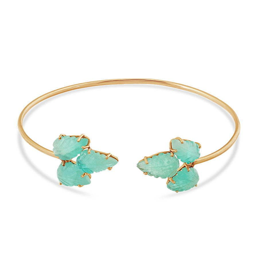 gold metal thin bracelet with green leaf stones photography
