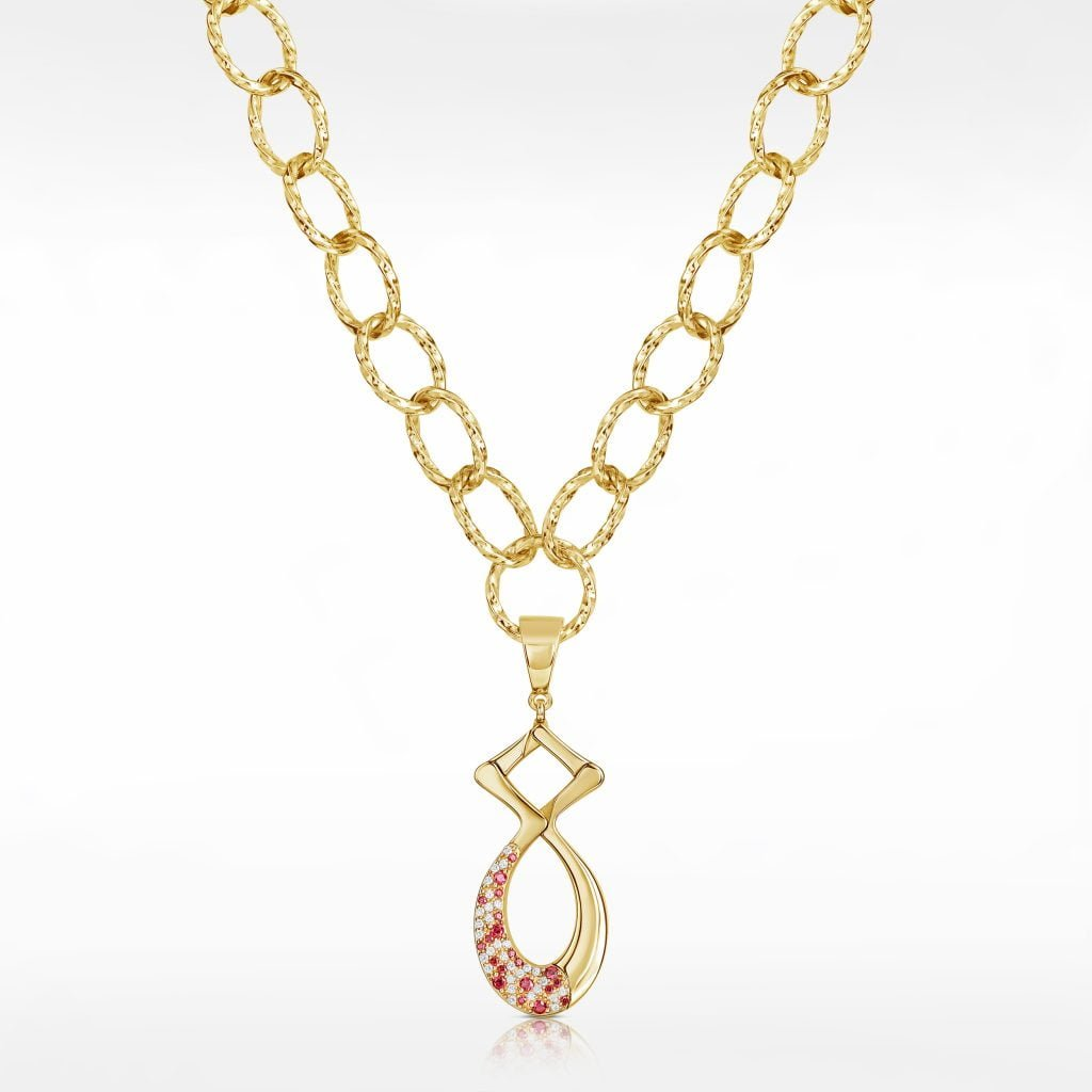 Yellow gold necklace photography on a grey background