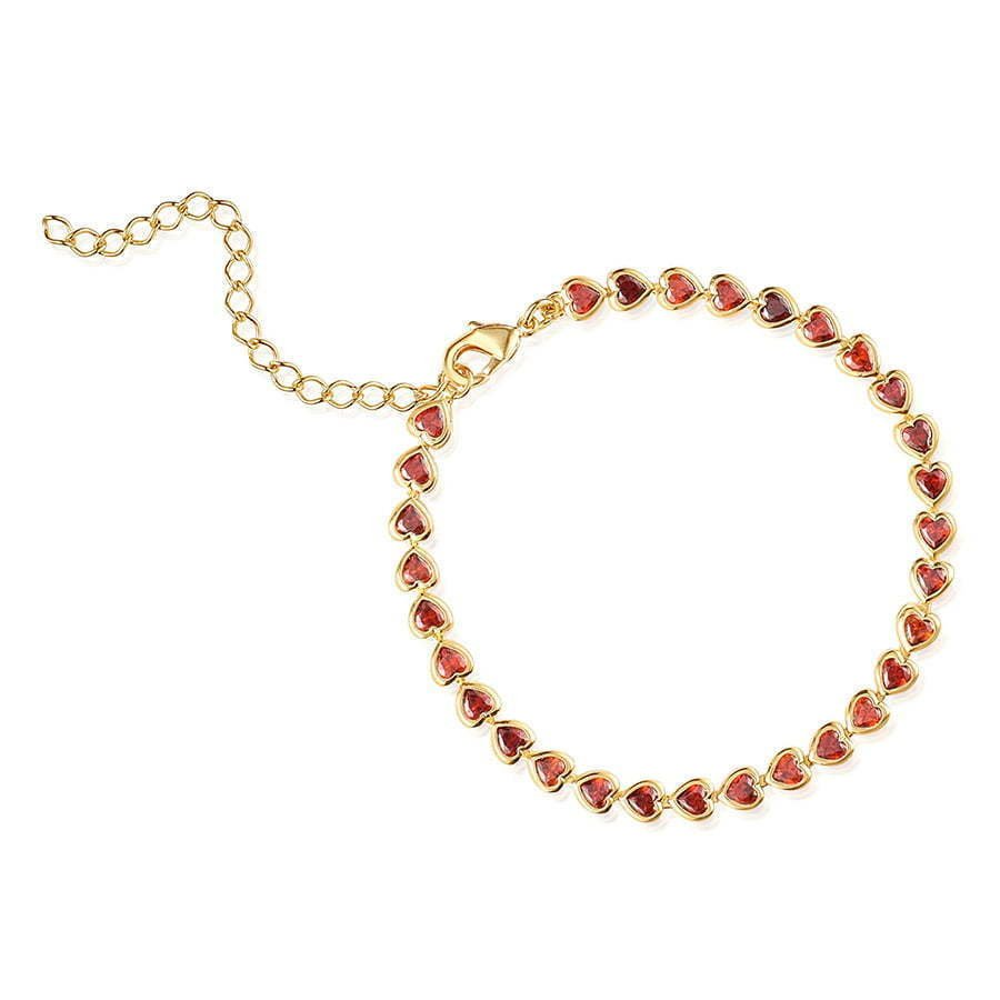 gold bracelet in a circle with red heart stones photography