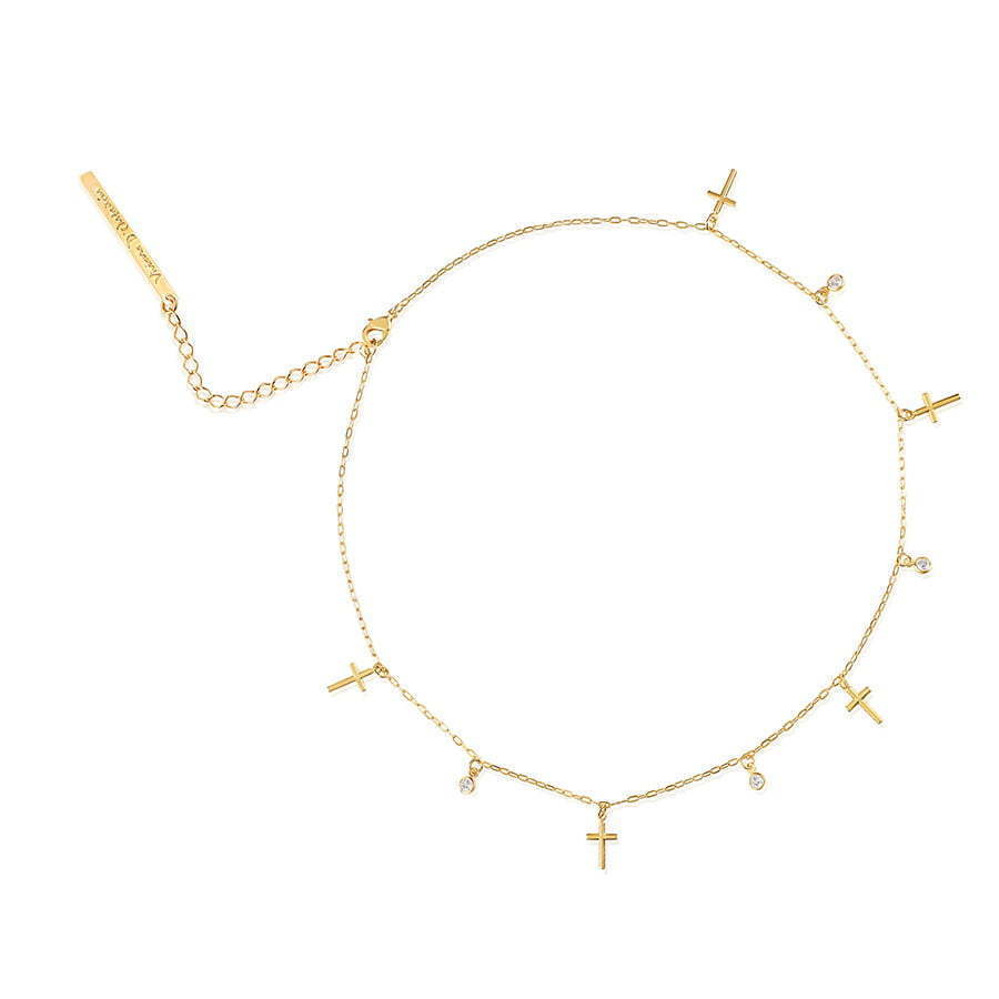 gold bracelet in a circle with tiny gold crosses hanging