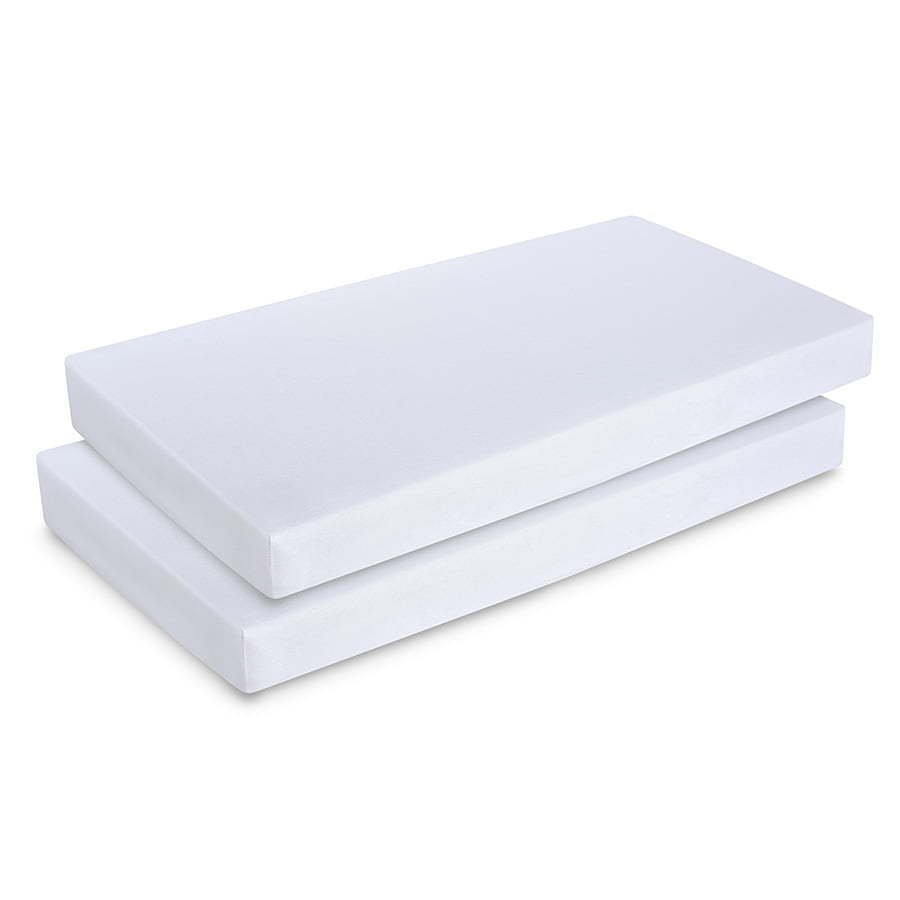 two White full baby crib mattresses photography