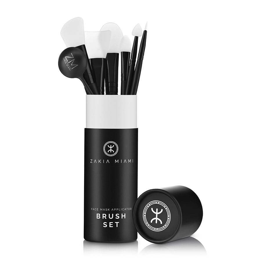 a photo of a cosmetic skincare brush set in tube packaging on a white background