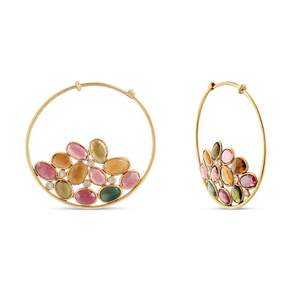 pair of hoop earrings with stones jewelry photography