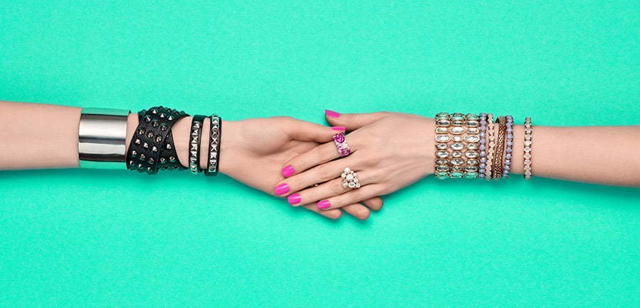 two-hand-holding-with-jewelry