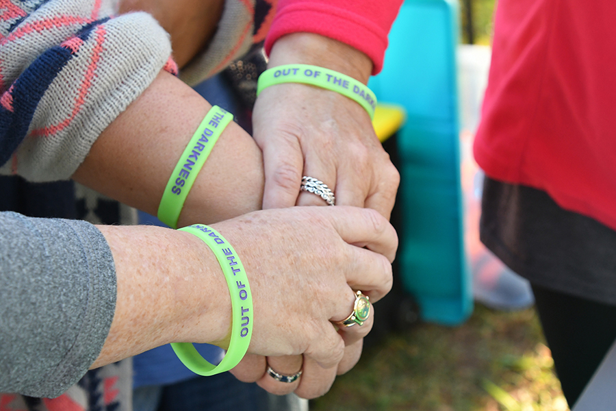 showing-support-hands-with-beads-bracelets-stacked