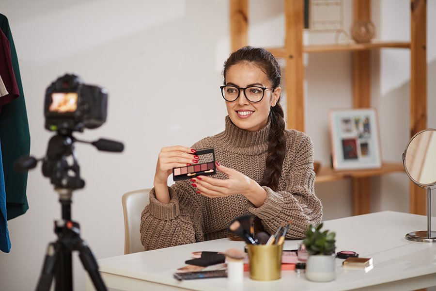 Smiling Young Woman Testing Make up Products for Video