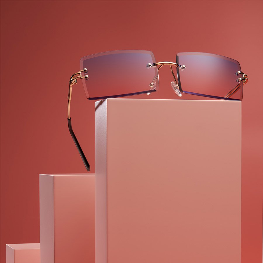 a_picture_of_sunglasses_photography_on_pink_background_on_blocks