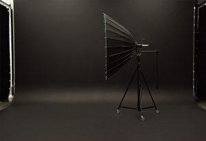 Big product photography studio light standing on black studio backdrop
