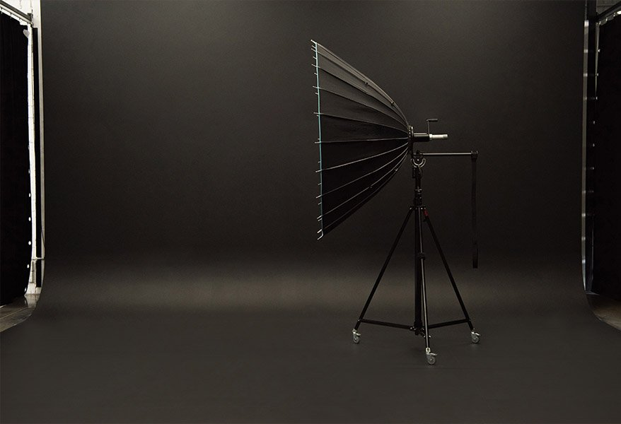 Big product photography studio light standing on black studio backdrop