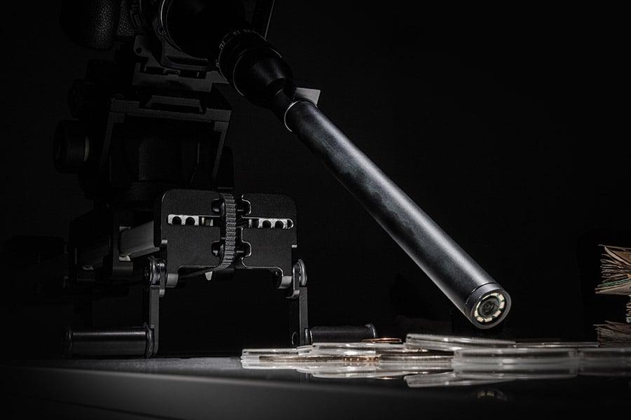 camera-with-probe-macro-lens-on-slider-taking-shot