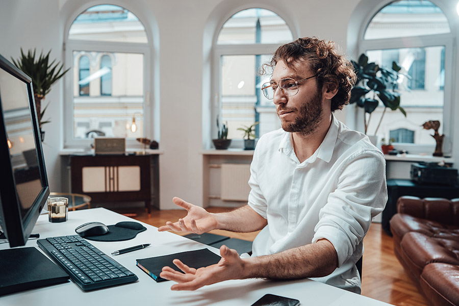 confused-guy-looks-at-computer-screen-and-throws-h