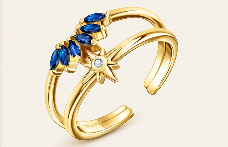 a_gold_diamond_ring_with_blue_gems